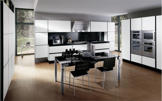Modern-kitchen-with-wood-floor-black-table-white-cabinets-and-drawers-with-build-in-stove