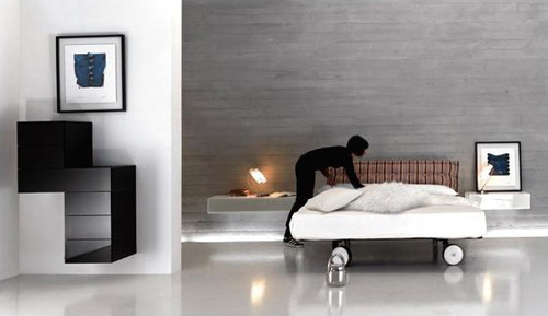 Elegant-bedroom-with-white-floor-with-night-lamps-and-white-double-bed-and-picture-of-walls-with-black-drawers